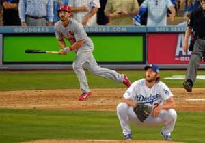 Matt Carpenter hits a double as Clayton Kershaw squats and watches, sadly.